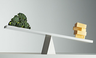 Photograph of brocolli and cheese balanced against one another on a see-saw